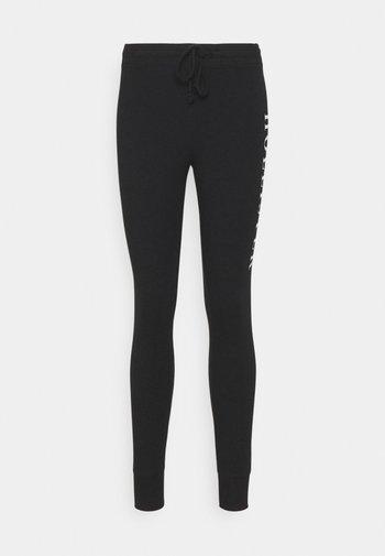 LOGO - Leggings - Trousers - black