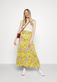 Desigual - FLORENCIA - Maxi skirt - yellow - 1