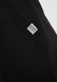 Cotton On Body - CROPPED GYM TRACKPANT - Pantalón 3/4 de deporte - black - 4