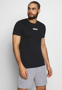 Jack & Jones - JCOZSS TEE SLIM FIT 2 PACK - T-shirts basic - white/black - 3