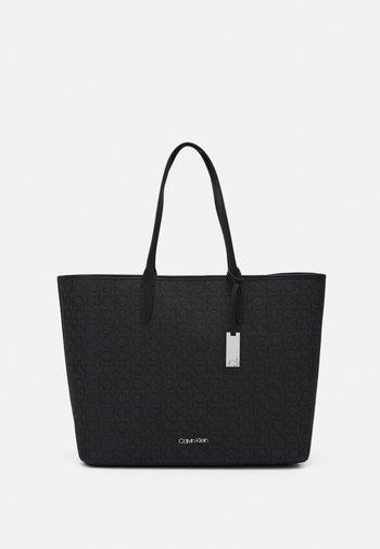 SHOPPER LAPTOP POUCH - Tote bag - black