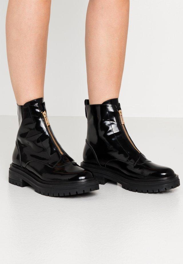 FRANKA ZIP - Platform ankle boots - black