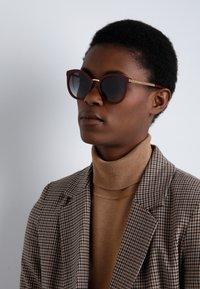Dolce&Gabbana - Sonnenbrille - bordeaux - 1