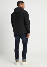 Alpha Industries - ANORAK FUNKTION - Light jacket - black - 2