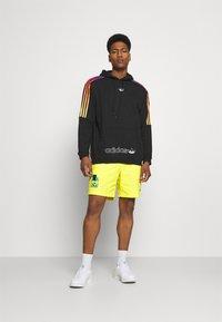 adidas Originals - WOVEN UNISEX - Shorts - acid yellow - 1