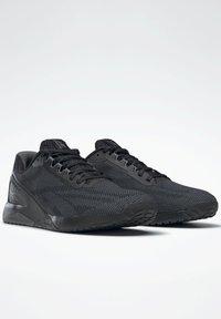Reebok - NANO X1 GRIT SHOES - Neutral running shoes - black - 1