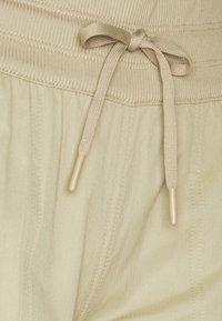 The North Face - WOMEN'S APHRODITE CAPRI - 3/4 sports trousers - twill beige - 5
