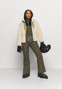 Brunotti - SUNLEAF WOMEN SNOWPANTS - Snow pants - sprout - 1