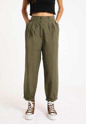 SLOUCHY - Trousers - grün