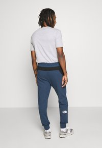 The North Face - STANDARD PANT - Tracksuit bottoms - blue wing teal - 2