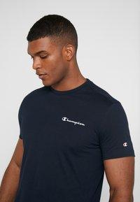Champion - CREWNECK  - T-shirt con stampa - dark blue - 3
