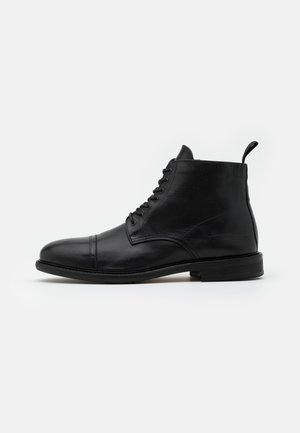 PILOT BOOTS - Lace-up ankle boots - black