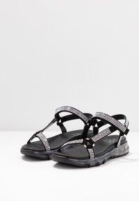 Toral - Sandaalit nilkkaremmillä - black - 4