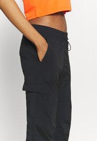 Peak Performance - HIT PANT - Trousers - black - 4
