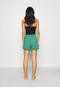 women'secret - SHORT PANT - Pyjama bottoms - green - 2