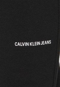 Calvin Klein Jeans - MICRO BRANDING PANT - Tracksuit bottoms - black - 2