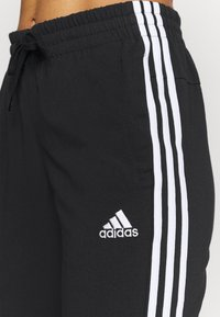 adidas Performance - 3/4 sports trousers - black/white - 3