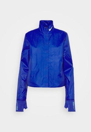 INFLATABLE JACKET - Chaqueta de entretiempo - hyper blue