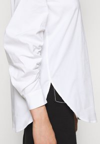 Steffen Schraut - CLEMANDE FANCY SLEEVE BLOUSE - Button-down blouse - white
