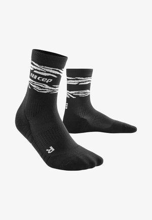 ANIMAL COMPRESSION MID CUT SOCKS - Sports socks - black/white
