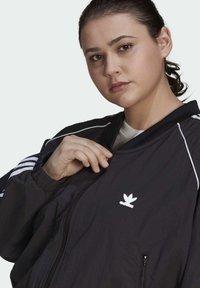 adidas Originals - SHORT TT - Training jacket - black - 4