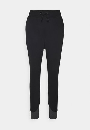 PREMIUM CORE TAPERED PANT - Verryttelyhousut - black