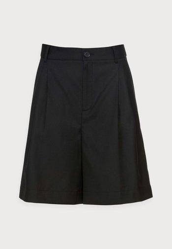 HILDI - Shorts - black