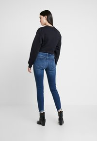 Calvin Klein Jeans - 010 HIGH RISE SKINNY ANKLE - Jeans Skinny Fit - aces high blue - 2