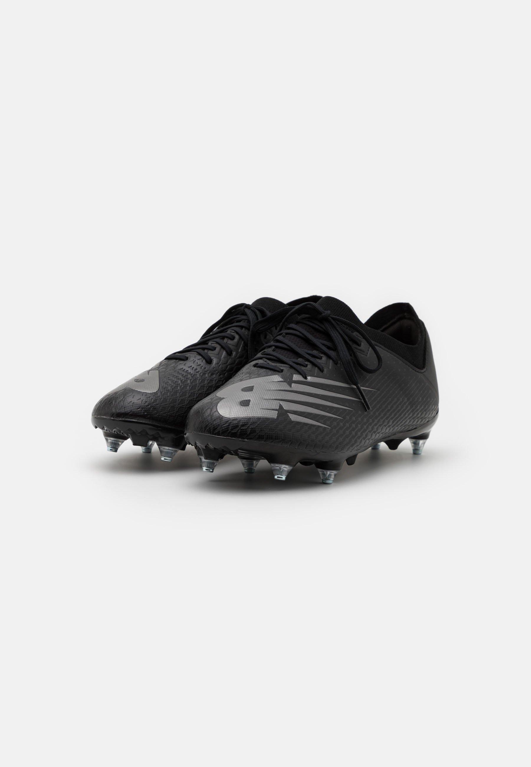 Scarpe da calcetto con tacchetti - black