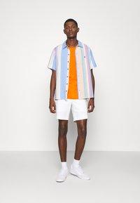 Polo Ralph Lauren - CUSTOM SLIM FIT JERSEY CREWNECK T-SHIRT - Basic T-shirt - sailing orange - 1