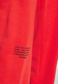 Nike Sportswear - PANT - Tracksuit bottoms - crimson/black - 4