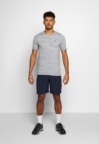 Salomon - CAMO TEE - T-shirt med print - alloy/heather - 1