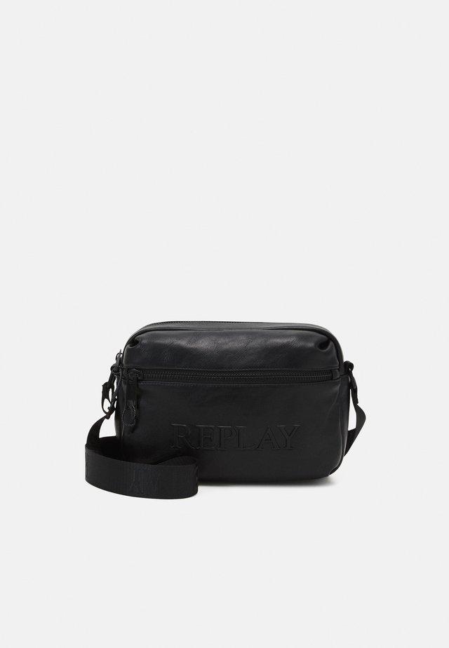 SOFT BAG UNISEX - Sac bandoulière - black