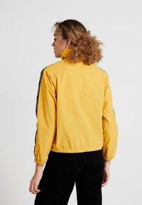 Obey Clothing - JAX TRACK ZIP - Summer jacket - mustard - 2