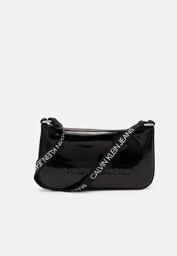 PROVOCATIVE SHOULDER BAG UNISEX - Across body bag - black