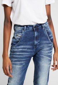 Diesel - FAYZA-NE JOGGJEANS - Relaxed fit jeans - indigo - 4