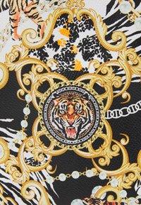 ALDO - GWAMMA SET - Across body bag - black/gold multi - 4