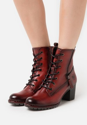 CATHY EVO - Lace-up ankle boots - red