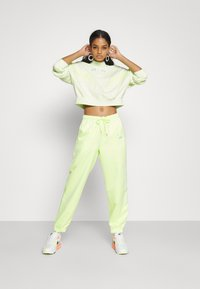 Nike Sportswear - Tracksuit bottoms - lime ice/white - 3