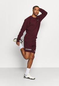 Under Armour - GRAPHIC SHORT - Sports shorts - bordeaux - 1