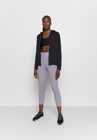 Under Armour - MERIDIAN CROP - Leggings - slate purple