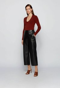 BOSS - TAOMIE - Leather trousers - black - 1