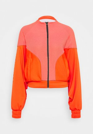 COVER UP - Training jacket - active orange/black