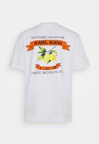 Karl Kani - UNISEX SMALL SIGNATURE TEE - T-shirt imprimé - white - 7