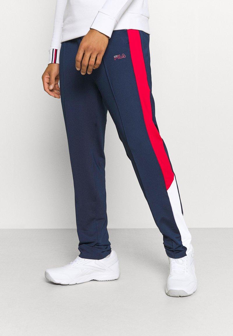 Fila - PALTI  PANTS - Teplákové kalhoty - black iris/true red/bright white