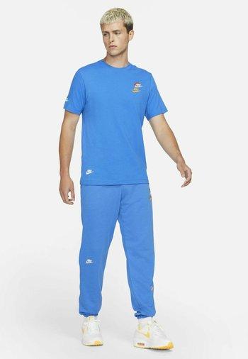 T-shirt print - signal blue