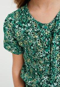 WE Fashion - MET DESSIN - Jumpsuit - dark green - 1