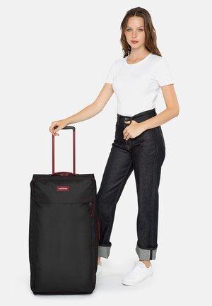 Wheeled suitcase - blakoutstripred