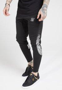 SIKSILK - ATHLETE TECH FADETRACK PANTS - Tracksuit bottoms - black/silver - 0