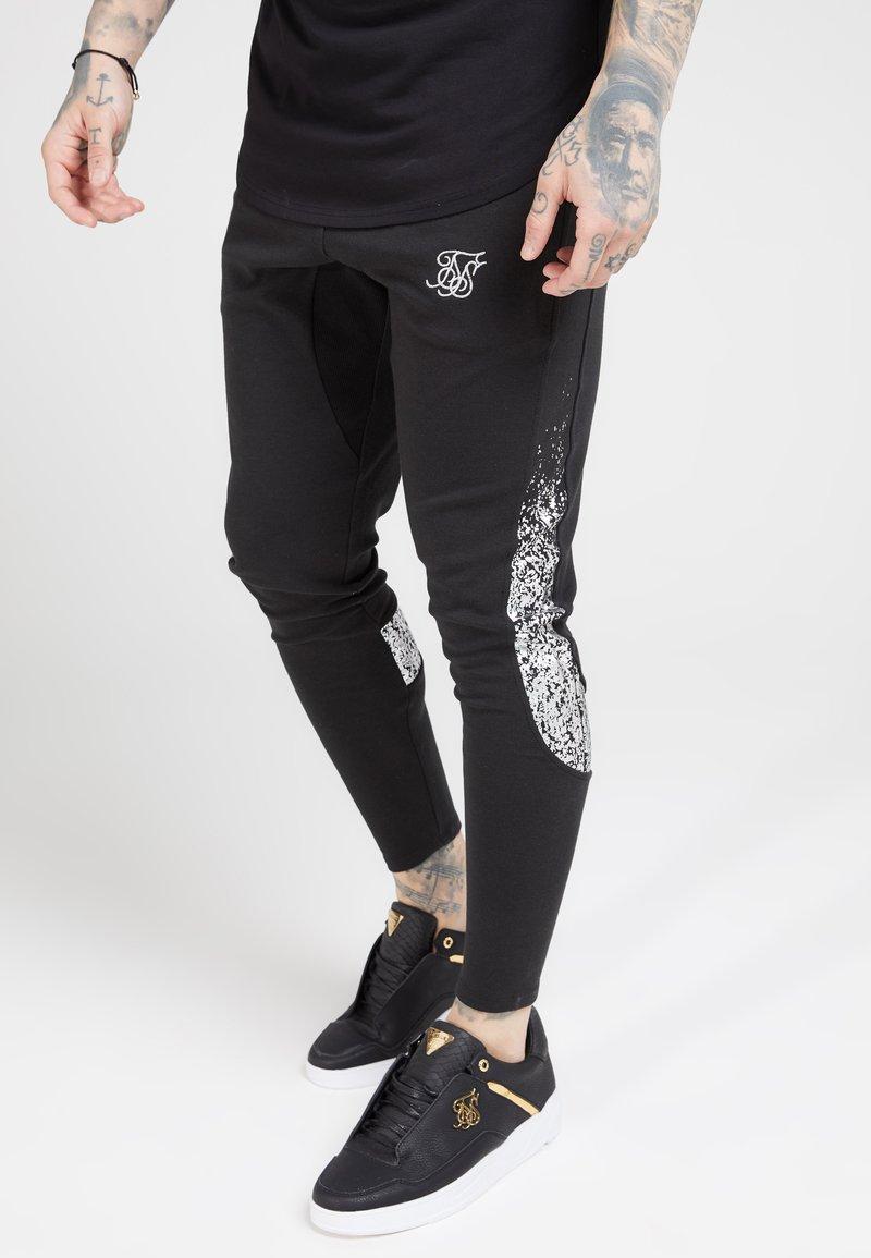 SIKSILK - ATHLETE TECH FADETRACK PANTS - Tracksuit bottoms - black/silver